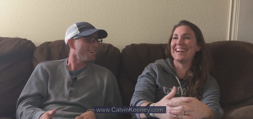 Calvin Keeney and Casey Dickerson talking and laughing on the couch