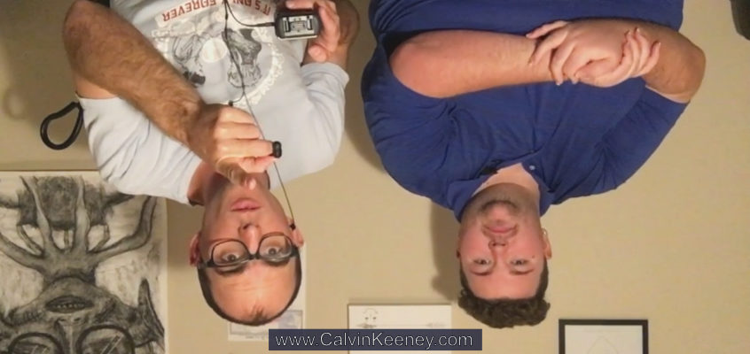 Calvin Keeney and Blaze Kunkel upside down looking at the camera. Calvin is pointing at the camera and Blaze has his arms crossed