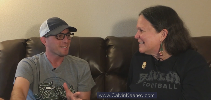 Calvin Keeney in a Teenage Mutant Ninja Turtle Shirt talking to his mom Charlotte Pisors on the couch