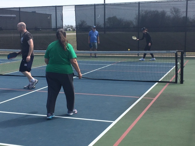 4 Beginner Pickleball Players Playing Pickleball