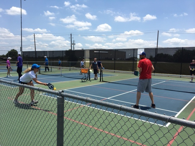 Several USTA staff members learning pickleball at an event in Austin Texas