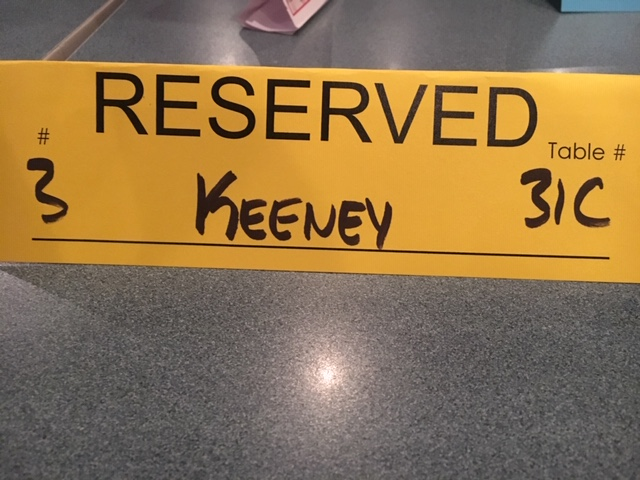 Image of a table reservation paper for Calvin Keeney at Cap City Comedy Club in Austin, Texas to see Tom Green